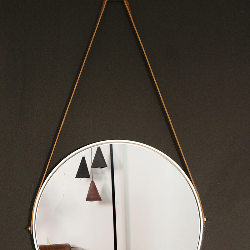 Small round mirror with leather strap